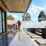 Landscaping Professionals Working On Patio Flooring Construction